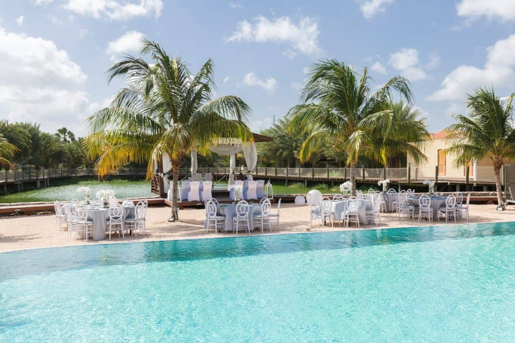 Wedding setup with pool & lake view Acoya Curacao