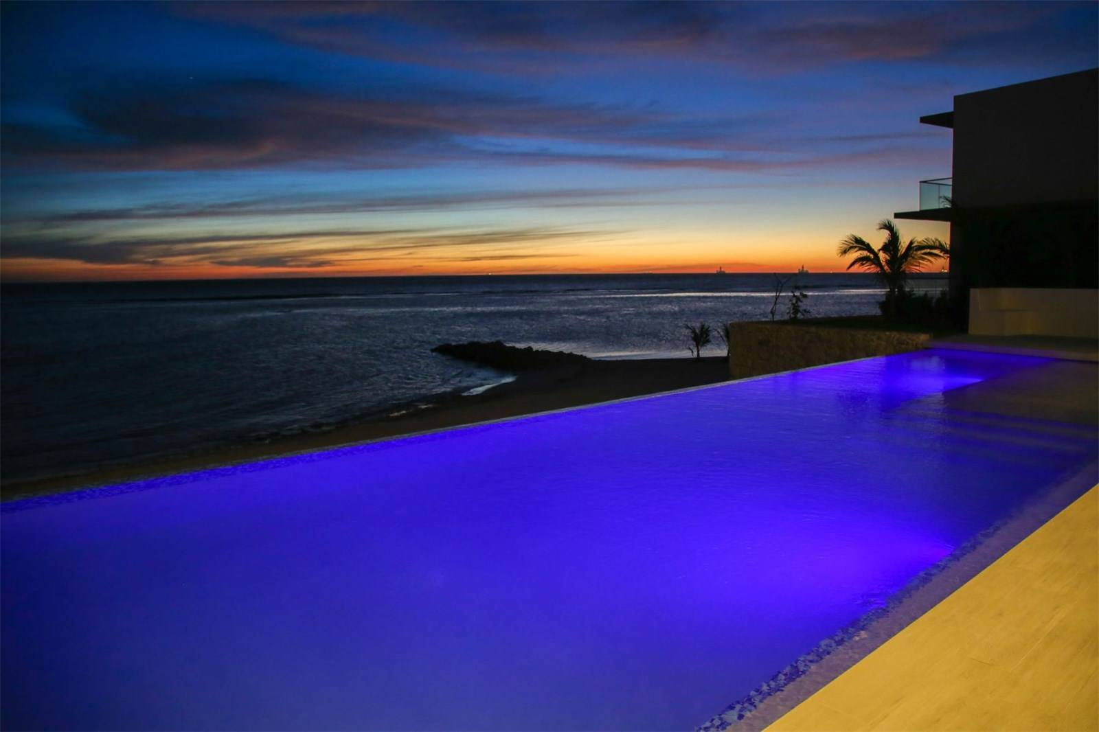Aruba Beachfront Estate pool by night