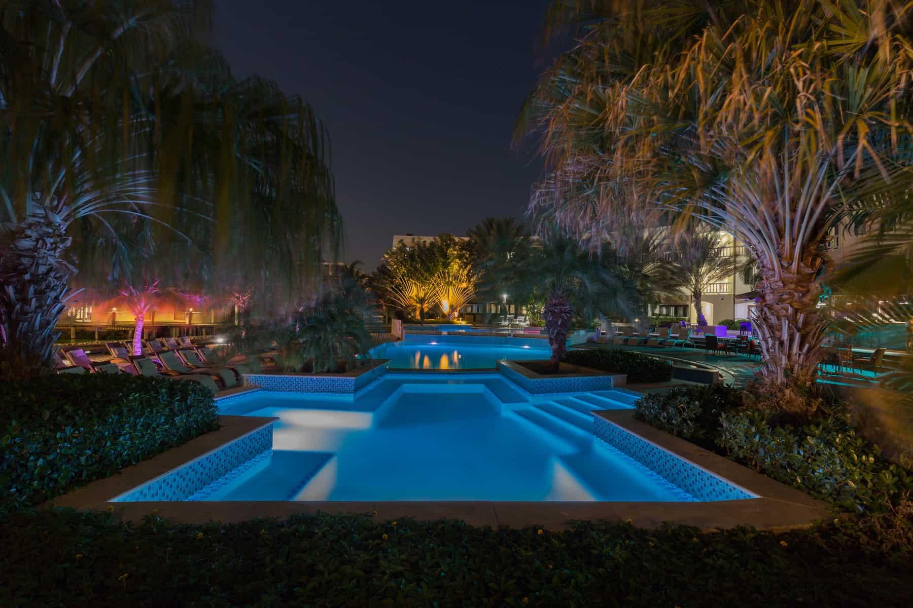 Swimming pool night view Acoya Curacao