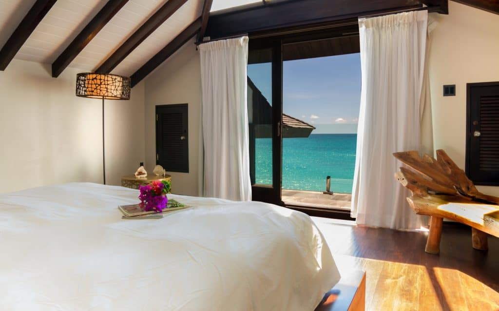 bed with ocean view and beach