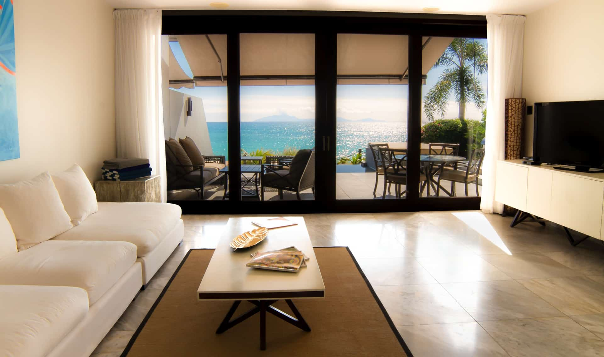 living room with view of the ocean