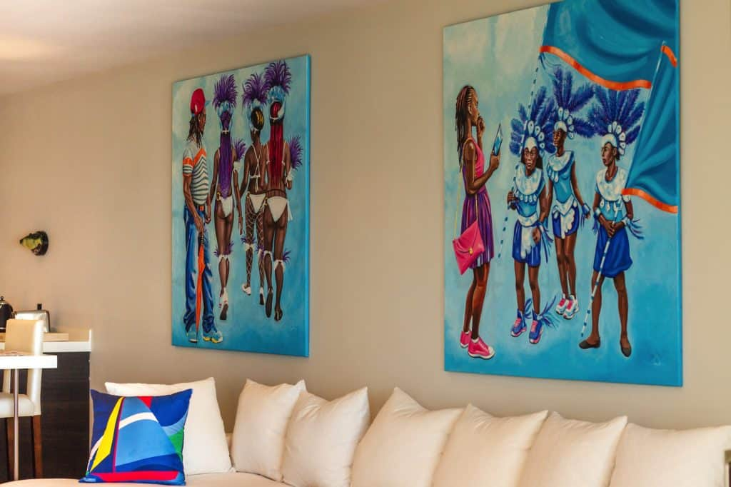 couch with paintings of children