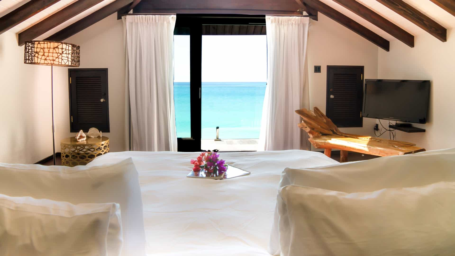bedroom with ocean view and bed